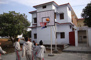 Boarding school student playing basket ball
